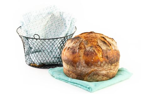 A homemade baked loaf of round artisan white sourdough bread isolated on white. 版權商用圖片