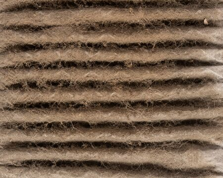 Close up of HVAC home air filter showing the dirt and particle cause bacteria inflection and sickness.