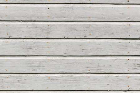 White wooden wall with rich texture, cracks, knots and nails. Weathered timber planks background. 스톡 콘텐츠
