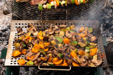 Healthy eating concept: Grilled vegetables on fire in a grill pan. 스톡 콘텐츠