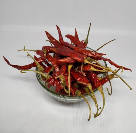 Dry red chilli peppers. Isolated on white background Stock Photo.this photo is taken by vishal singh