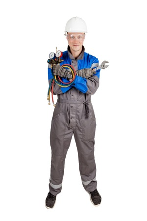 Builder, installer of ventilation with tools in hands. Stock Photo