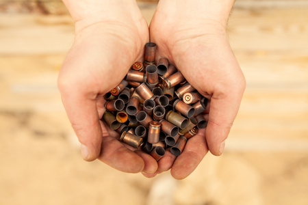 Cases of cartridges in the hands