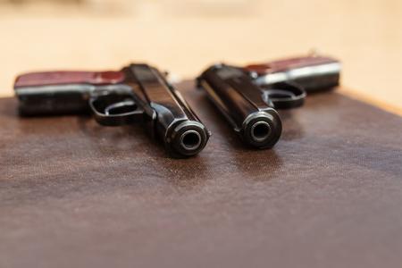 pistol lies on the table 版權商用圖片