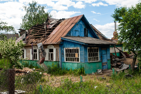 a house with a broken roof