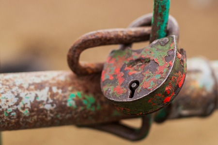 Old padlock in red color