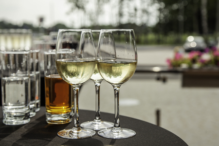 Glasses with white wine on a buffet table