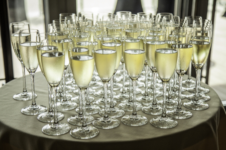 Glasses with cold champagne at the banquet