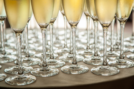 Glasses with cold champagne at the event