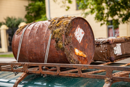 Rusted barrel in the trunk of the car