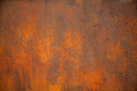 The texture of the rusty metal is orange and brown