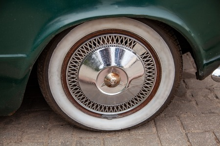 Wheel of a retro car standing on the street