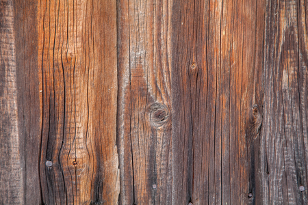 Texture of an old wooden board in brown color
