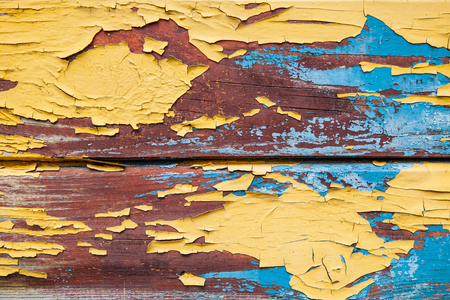 Old boards painted in yellow and blue color