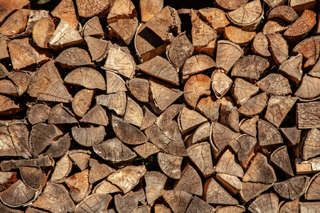 Firewood for firewood, Background of dry chopped firewood logs in a pile Stock Photo