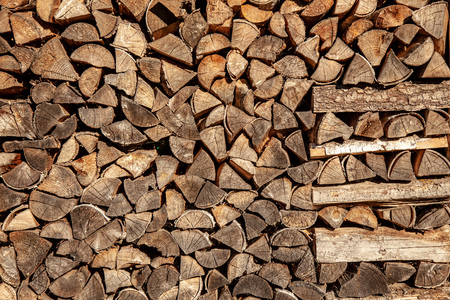 wall firewood , Background of dry chopped firewood logs in a pile Stock Photo