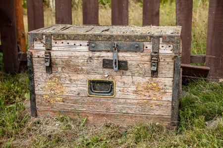 Old wooden storage chest on the grass Stock Photo