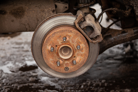 Old brake disc in the car, security Stock Photo