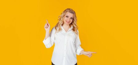 Pretty blonde woman smiles, gives advice, pointing sideways left and right, showing a good choice promotes two products, both ways