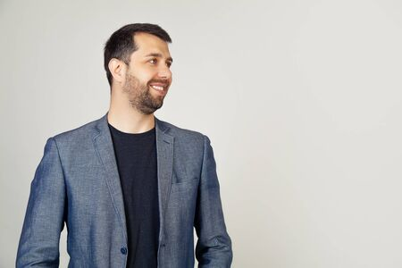 Closeup of a handsome bearded guy in a jacket standing in profile Stockfoto