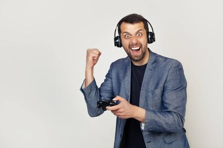 A gay male gamer playing a video game annoyed and upset screams with anger