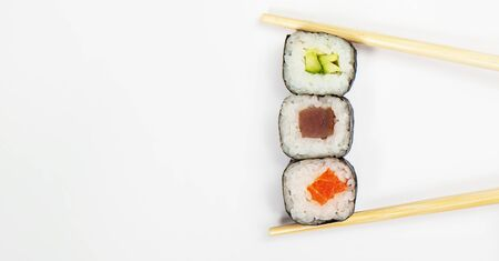 Japanese kitchen. Various sushi and rolls with fish cheese and with chuka salad