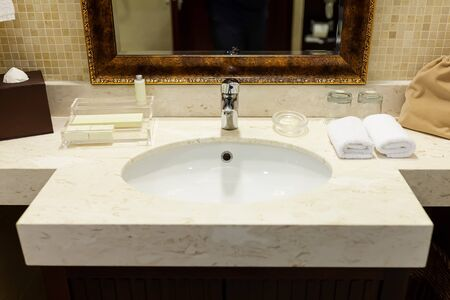 Bathroom interior with sink and faucet. The modern design of the bathroom