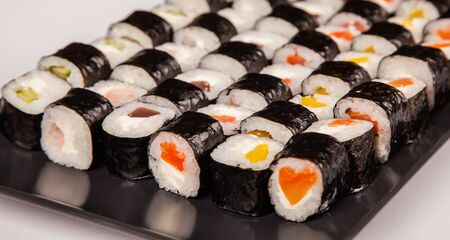 Hoso sushi set and rolls for sushi heart symbol. Various sushi and rolls with fish cheese heart shape. Isolated over white background. Japanese kitchen.