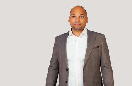 A smart confident black African-American young man, in a shirt and a jacket, a smart look, confident in his success Stockfoto