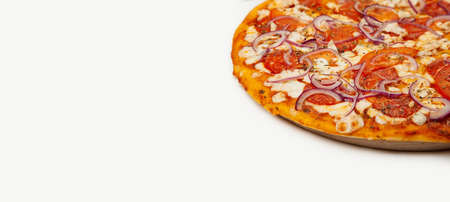 Delicious Rustic pizza. Signature sauce, mozzarella cheese, pepperoni, chicken fillet, tomatoes, red onion. Close-up. Advertising flyer and poster for restaurants. With copy space for text