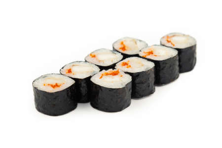 Sushi mini roll with fried sea bass on a white plate, ingredients fried bass, flying fish roe, rice, nori. Traditional Japanese food. For the restaurant menu