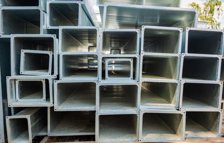 Ventilation pipe warehouse. Steel pipes, parts for the construction of air ducts for an industrial air conditioning system in a warehouse. Industrial airway ventilation equipment and piping systems