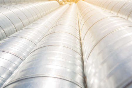 Ventilation pipe warehouse. Steel pipes, parts for the construction of air ducts for an industrial air conditioning system in a warehouse. Industrial airway ventilation equipment and piping systems.