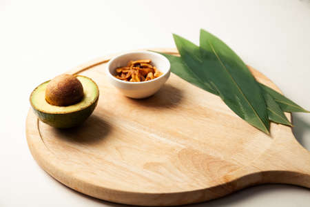 Avocado and nuts on a wooden board. Healthy food rich in protein. Ingredients full of healthy fat on the table. High quality photo