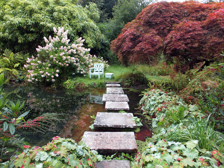 stepping on: stepping stones over an ornamental pond Stock Photo