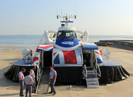 14th July 2018. Ryde, Isle of Wight. A hovercraft and its crew wait for the next passengers to embark. The hovercraft travels between Ryde and Southsea across the Solent.