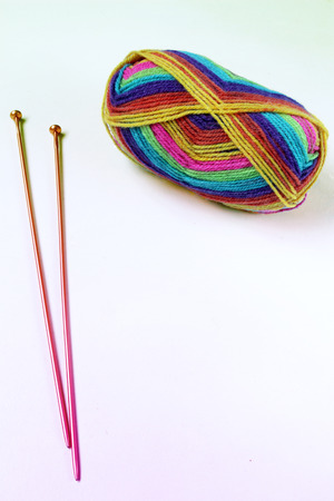 Colourful Ball of Wool and Knitting Needles Isolated on a White Background