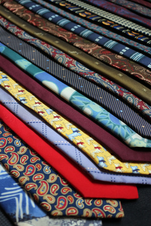 A row of different coloured and patterned ties