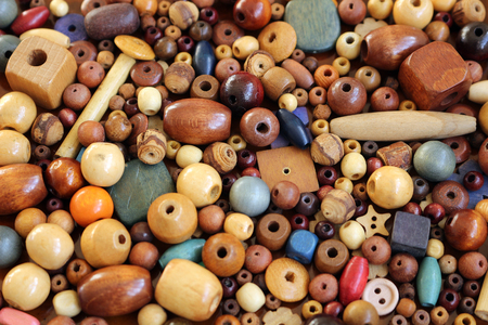 A pile of different wooden beads for making jewellery items Banco de Imagens
