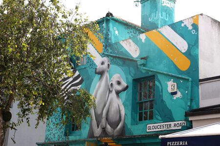 10th September 2019. Brighton, East Sussex, England. Graffiti artwork of meerkats on a building Фото со стока - 135344374