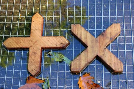 Wooden Crosses in a Water Feature