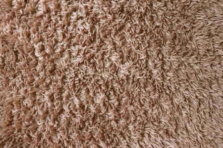 Close up of brown furry material Фото со стока