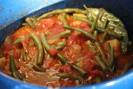 Fasolakia Lathera. A Greek dish with stewed green beans, tomatoes and potatos. The ingredients are vegan and it can be eaten during Great Lent. Фото со стока