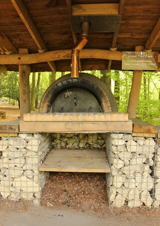 The covered outdoor pizza oven at Queen Elizabeth Country Park, Hampshire, England