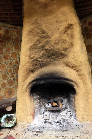 A cob fireplace in a cordwood constructed building