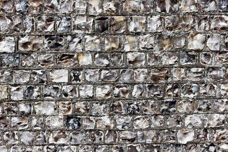 texture of a flint stone wall Фото со стока