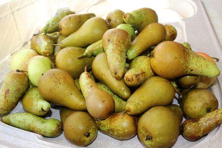 A pile of fresh green pears