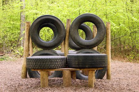 Horndean, Hampshire, England. 23rd April 2019. An Obstacle Course with Tyres at Queen Elizabeth Country Park Фото со стока - 135344425
