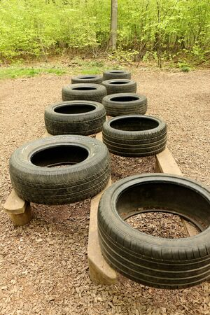 Horndean, Hampshire, England. 23rd April 2019. An Obstacle Course with Tyres at Queen Elizabeth Country Park Редакционное