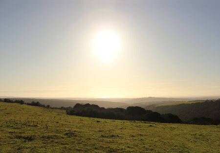 A view from Butser Hill towards the Isle of Wight, with the Solent shining on the horizon. Фото со стока